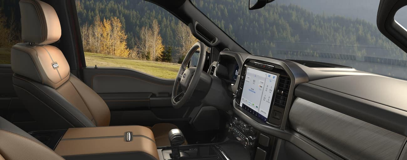 The tan interior of a 2021 Ford F-150 is shown.