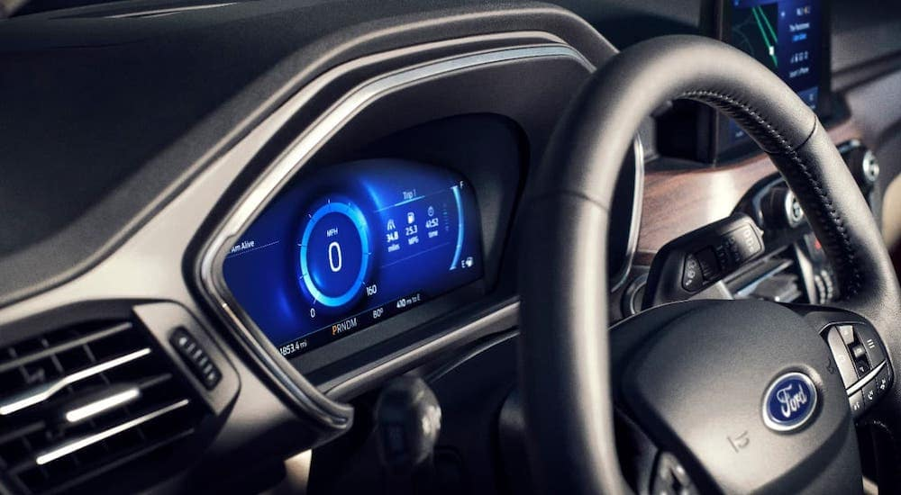 The information cluster in a 2020 Ford Escape is shown, leasing or buying one will qualify for Kings Ford FordPass rewards.