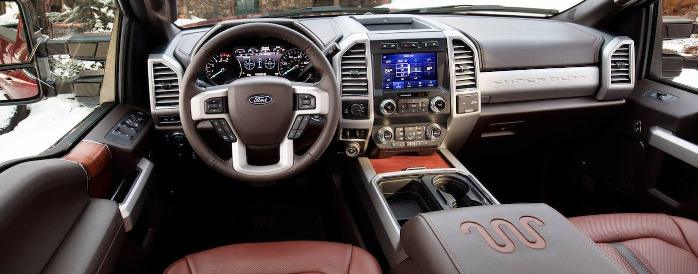 The interior of a 2020 Ford F-250 King Ranch is shown from the driver's perspective.