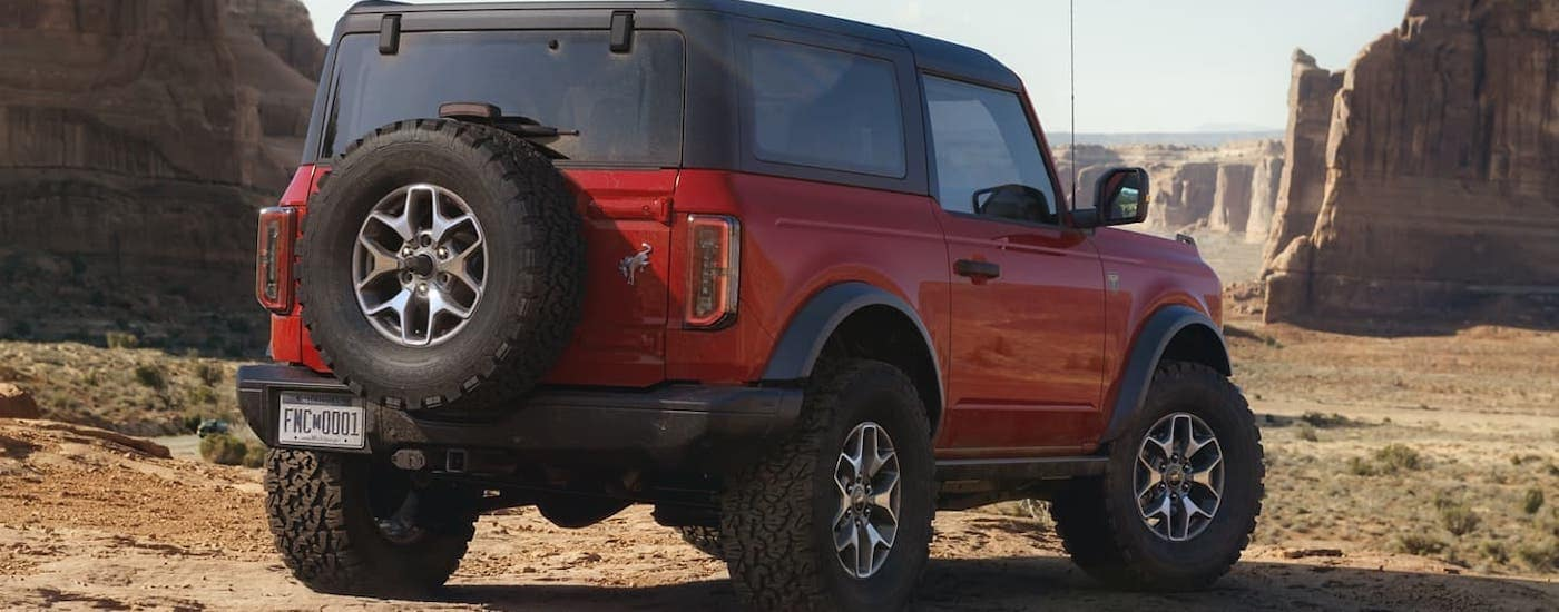 The rear of a 2021 Ford Bronco 2-door is shown while parked on a dirt trail outside Cincinnati, OH.