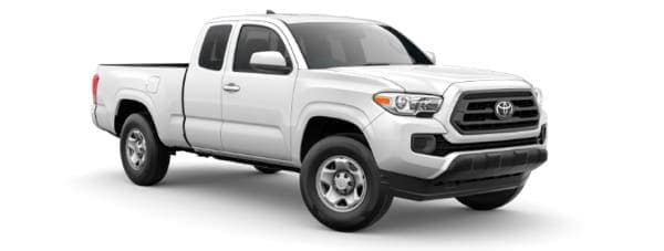 A white 2021 Toyota Tacoma is angled right.
