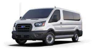 A white 2020 Ford Transit is angled left.