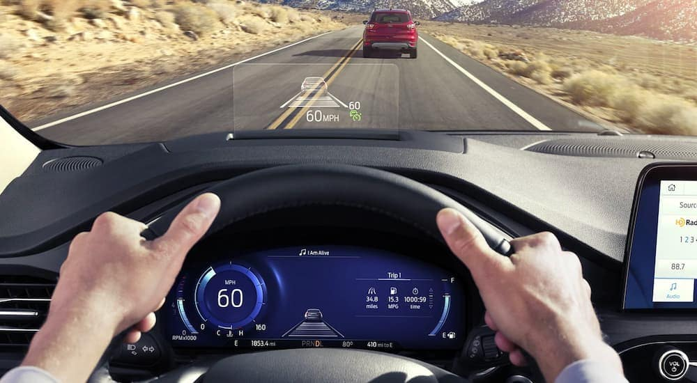 A close up is shown of the gauge cluster and HUD on a 2021 Ford Escape Hybrid.