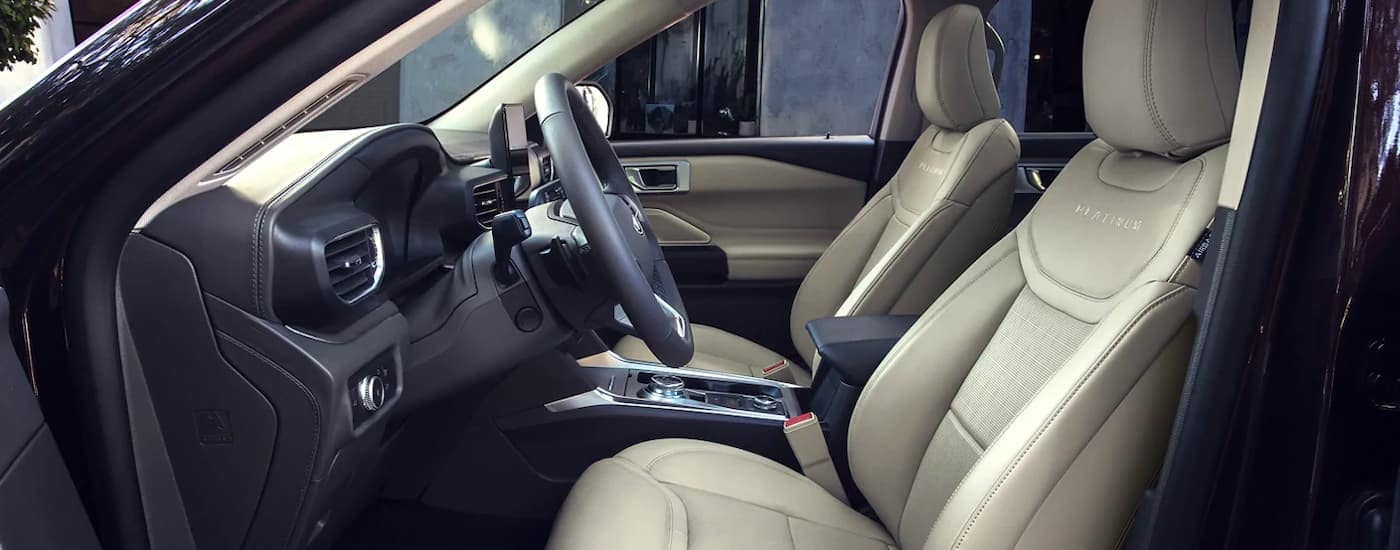 The gray and black interior is shown from the drivers side on a 2021 Ford Explorer.