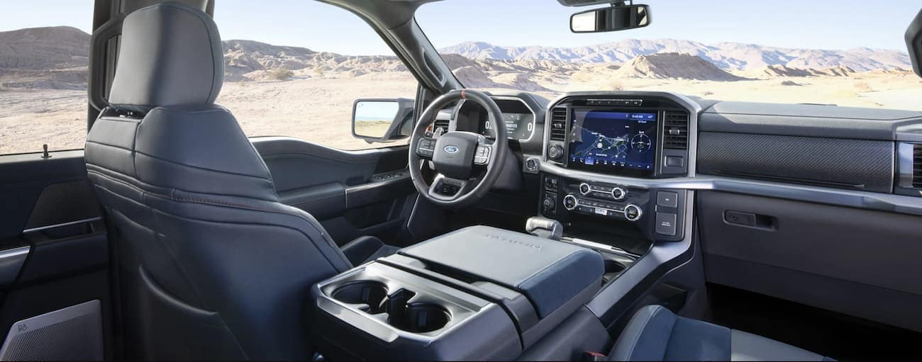 The grey interior in a 2021 Ford F-150 Raptor is shown.