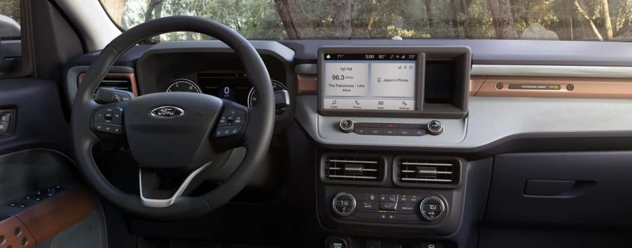 The interior of a 2022 Ford Maverick shows the steering wheel and infotainment screen.
