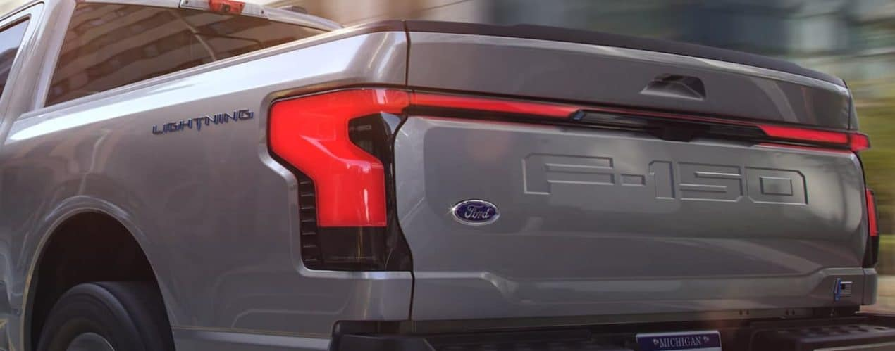 The taillight on a grey 2022 Ford F-150 Lightning is shown.