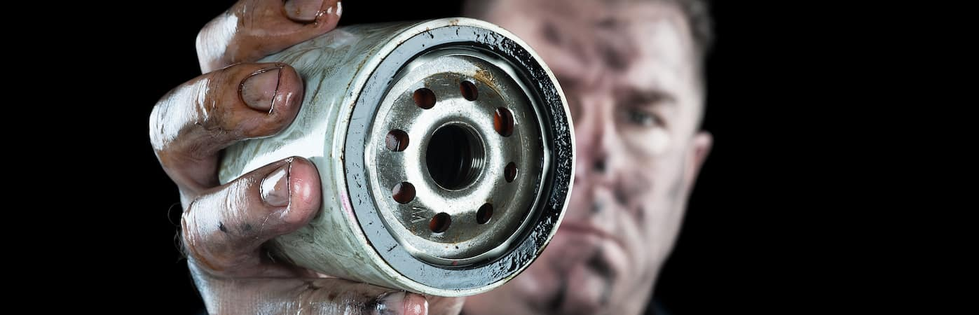 Closeup of oil filter in the hands of a mechanic