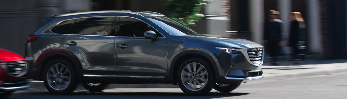 AWD Mazda CX-9 entering busy intersection
