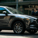 Mazda CX-5 driving in busy urban area