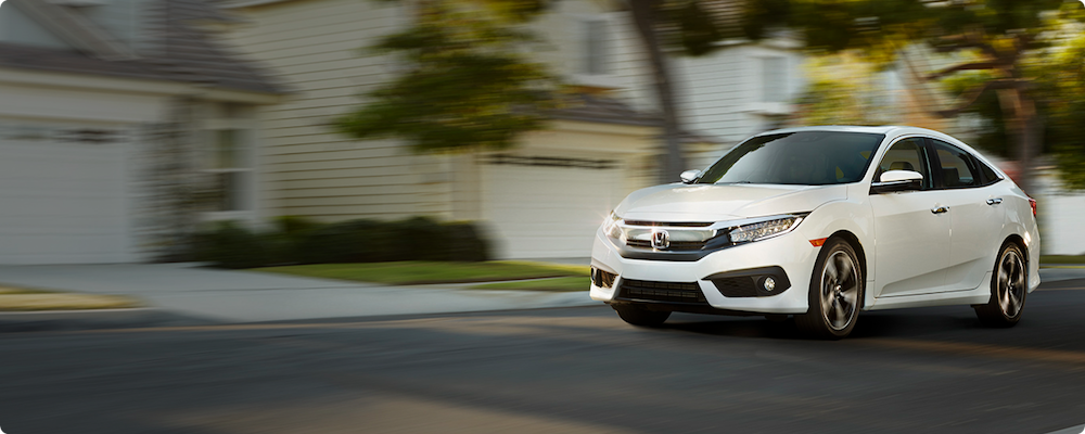 CPO Honda driving in suburbs