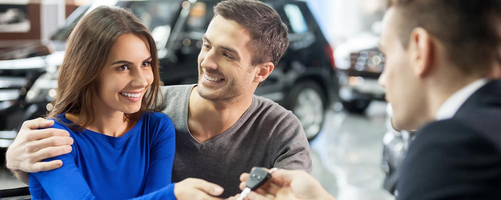 couple buying used car