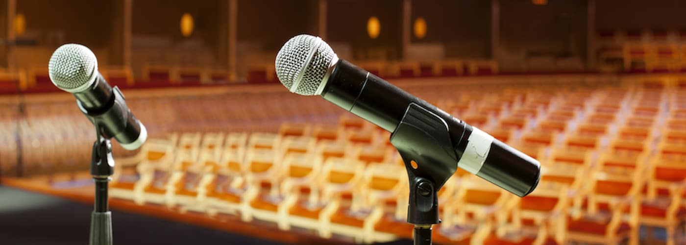 auditorium stage with microphones