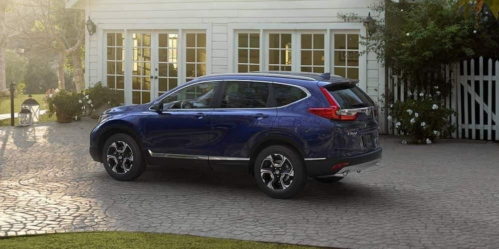 Blue Honda CR-V Parked Outside Home