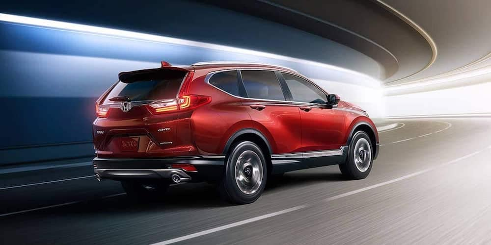 Red Honda CR-V Driving Through Tunnel
