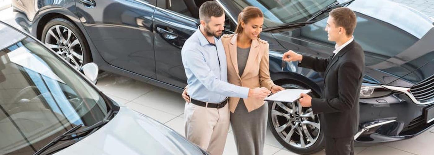 Couple in Dealership Getting Car Keys