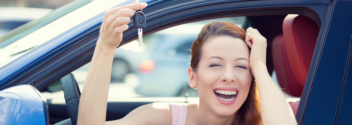 Woman Smiling Holding Car Keys
