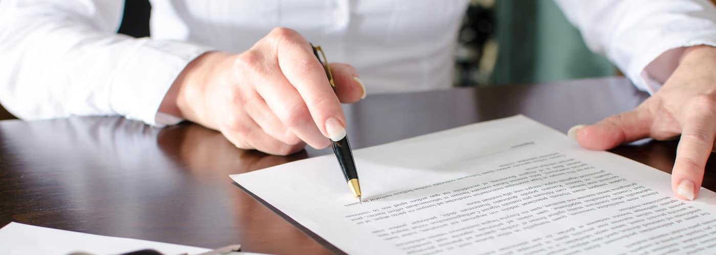 Woman Reading Through Contract