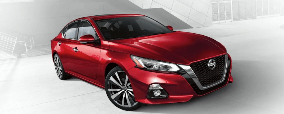 2019 Nissan Altima red on white patterned backdrop