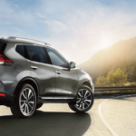 2019 silver nissan rogue on country road