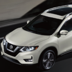 2020 Nissan Rogue driving down highway