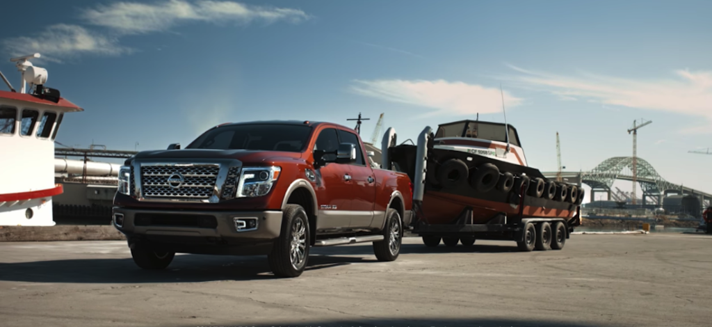 2019 nissan titan towing small boat with trailer
