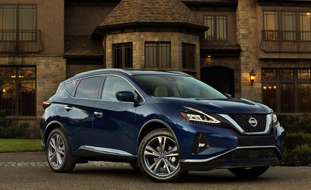 Image of a blue Nissan Murano SUV parked in front of a house.