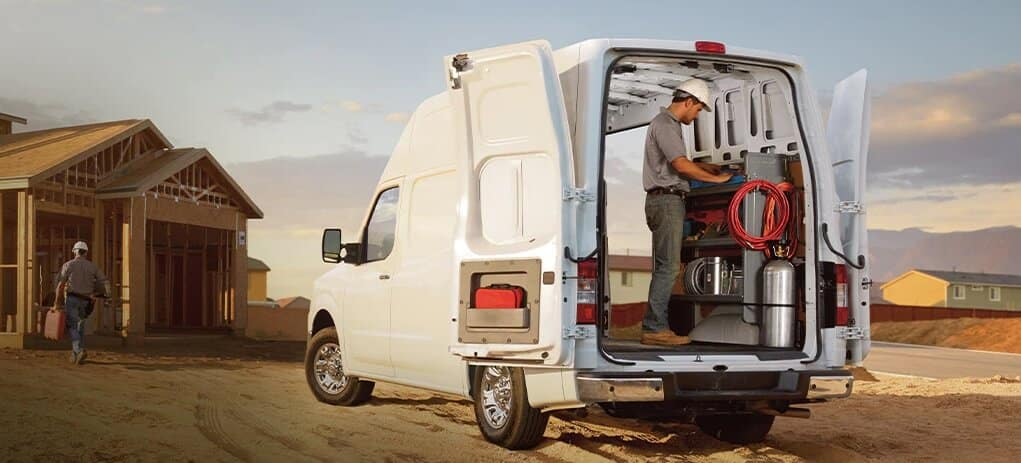 2021 Nissan NV Cargo Van Pictured With Construction Worker at Job Site