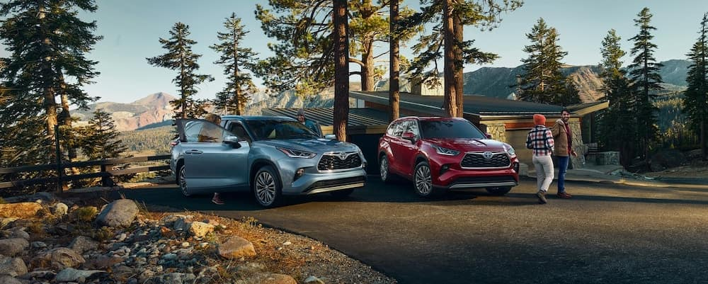 2020 Toyota Highlander models parked in front of a home