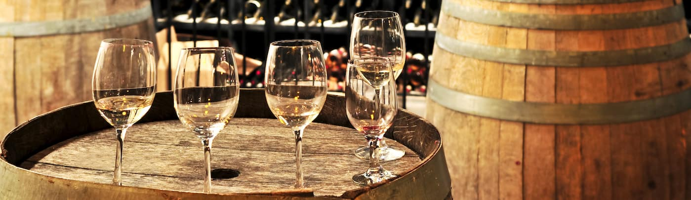 Wine Glasses on a Wooden Barrel