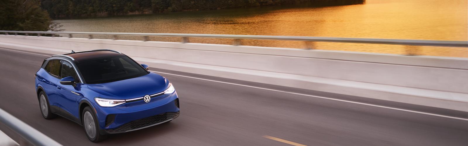blue atlas driving over bridge