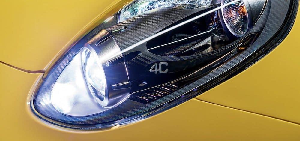 Yellow 2019 Alfa Romeo 4C headlight with 4C logo