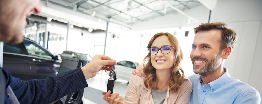 couple being handed keys to new car