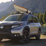 Black 2019 Honda Passport near campsite with canoe