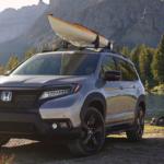Black 2019 Honda Passport near campsite with canoe