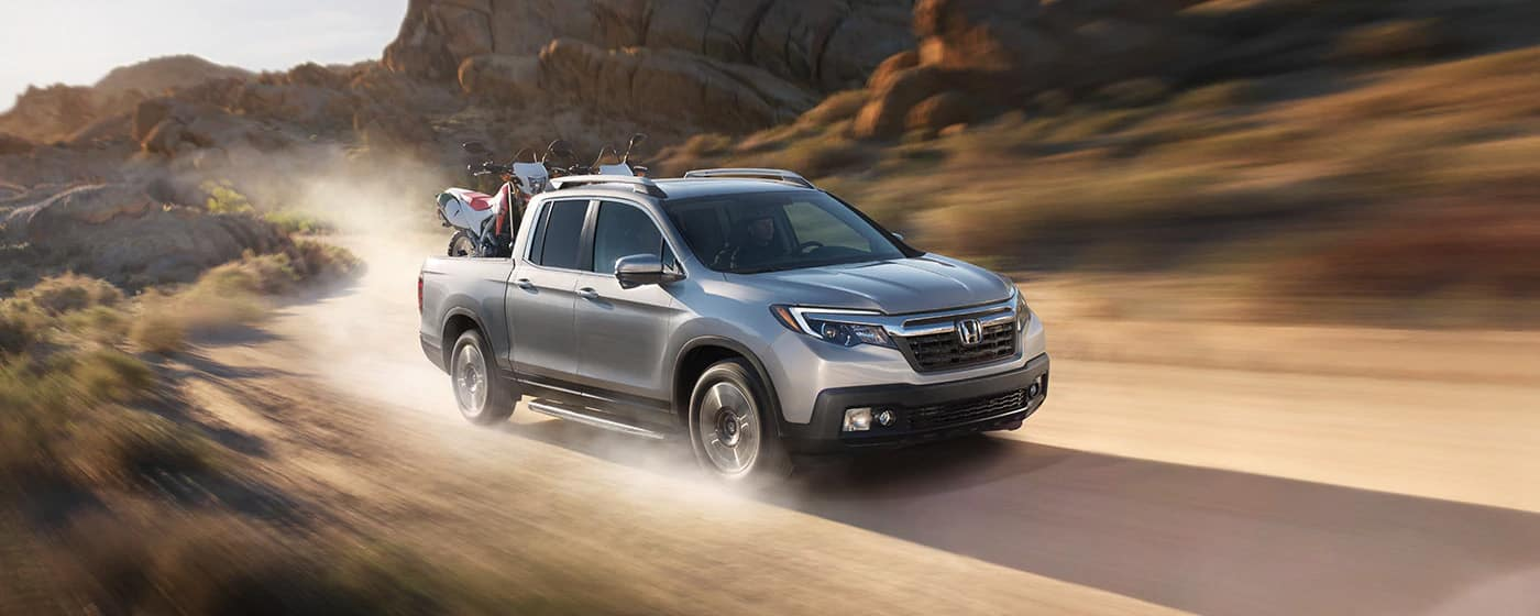 2019 Honda Ridgeline with motorcycles banner