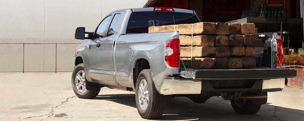2019 Toyota Tundra with a load of lumber stacked in the bed.