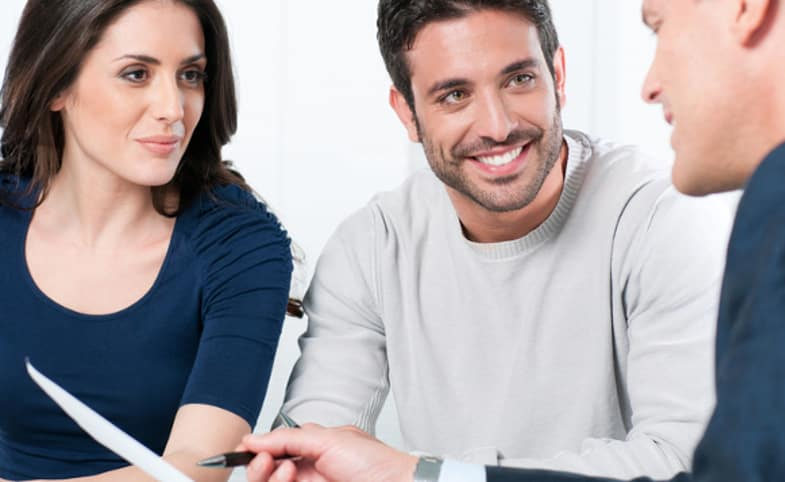 couple talking to finance guy