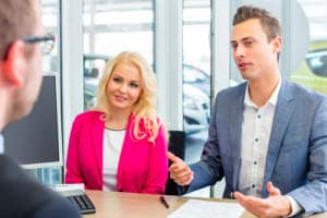 car buyers talking to auto financing specialist