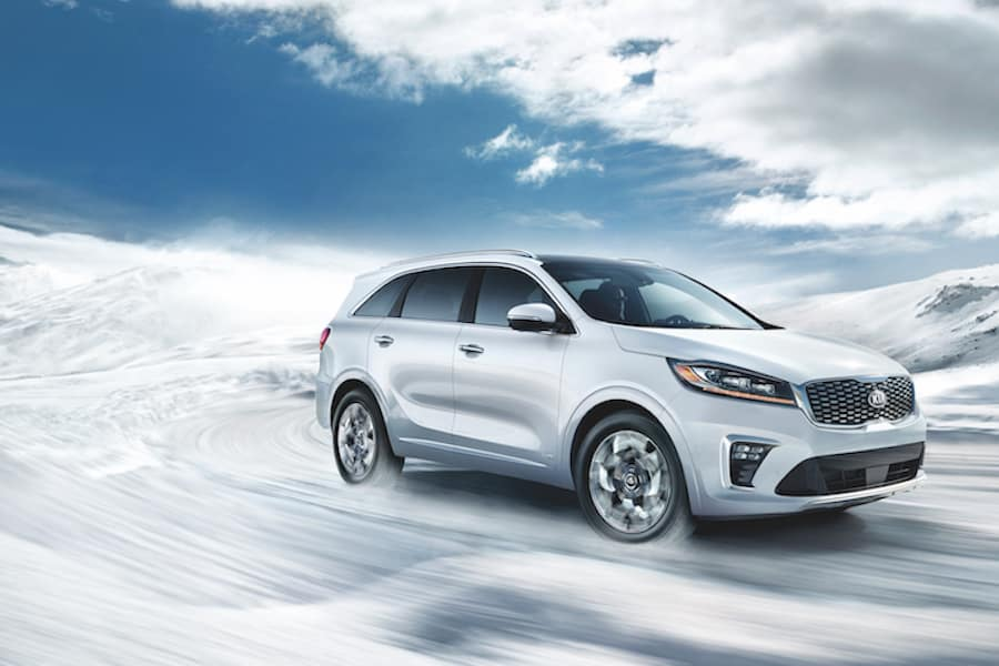 2019 Snow White Pearl Kia Sorento driving in snow