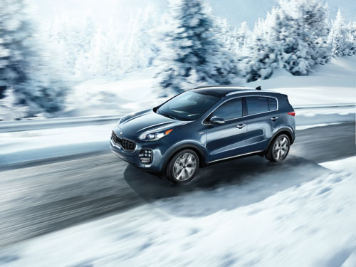 2018 Black Kia Sportage Driving in Snow