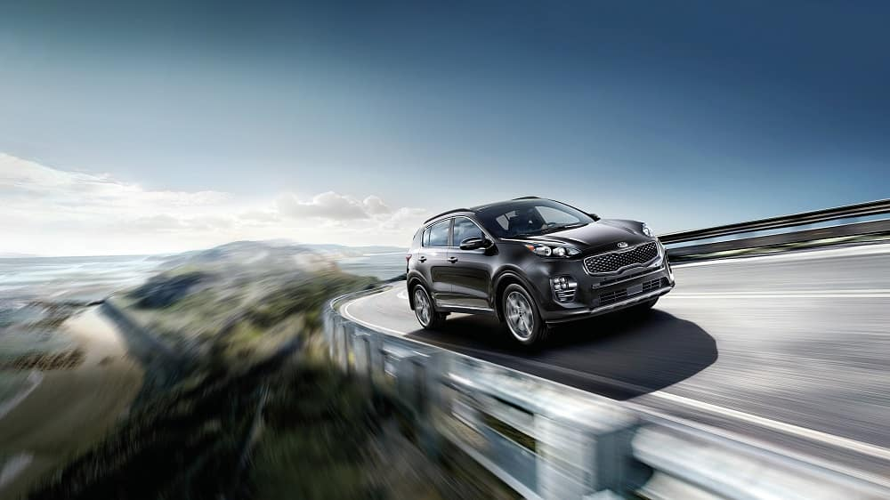 2019 Black Kia Sportage driving on highway