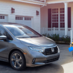 2020 Honda Odyssey utility banner photo with family in driveway