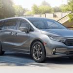 2021 Honda Odyssey Elite Trim Level parked in front of neighborhood park