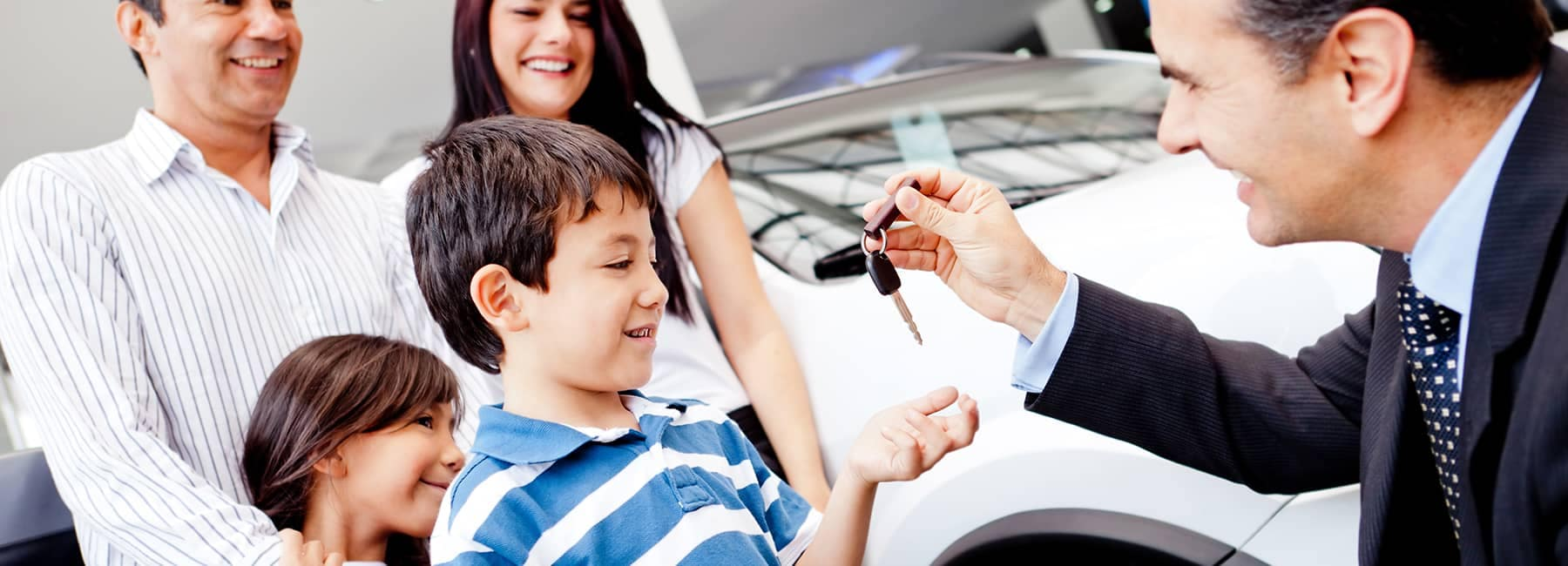 Child receiving keys to vehicle