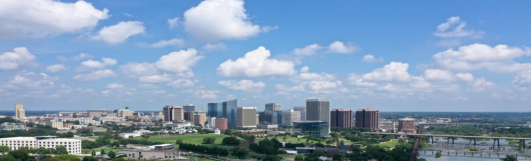 Beautiful shot of Richmond, Virginia skyline with a cloudy blue sky in the background