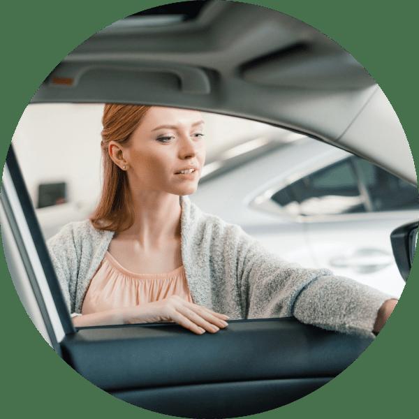 Woman reaching into driver's side car window